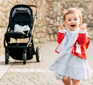Happy_toddler_girl_walking_with_stroller_behind_her_shutterstock_765494350_smlll