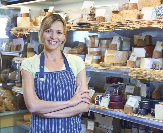 Owner_Of_Delicatessen_Standing_Next_To_Cheese_Display_shutterstock_244645438_1