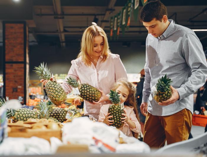 family-buying-fresh-pineapples-3985067